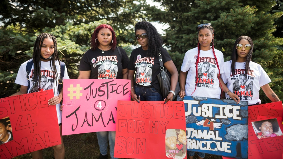 Kayla Francique, left to right, Lashana Francique, Anne Marie White, Latvia Francique and Richelle Reid, pose for a photograph during a community barbecue honouring the lives of their brother and son, Jamal Francique, and D'Andre Campbell, two black men who were killed by police in 2020, among others, in Brampton, Ont., on Sunday, August 23, 2020. THE CANADIAN PRESS/Tijana Martin