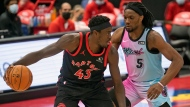 Toronto Raptors forward Pascal Siakam (43) tries to drive around Miami Heat forward Precious Achiuwa (5) during the first half of an NBA basketball game Wednesday, Jan. 20, 2021, in Tampa, Fla. (AP Photo/Chris O'Meara)
