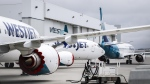 Grounded WestJet Boeing 737 Max aircraft are shown at the airline's facilities in Calgary, Alta., Tuesday, May 7, 2019. (THE CANADIAN PRESS/Jeff McIntosh)