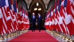 Prime Minister Justin Trudeau and US vice-president Joe Biden walk down the Hall of Honour on Parliament Hill in Ottawa on Friday, December 9, 2016. Democrat Joe Biden defeated President Donald Trump to become the 46th president of the United States on Saturday, positioning himself to lead a nation gripped by the historic pandemic and a confluence of economic and social turmoil. THE CANADIAN PRESS/Patrick Doyle