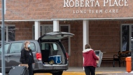 Workers arrive at the Roberta Place Long Term Care home in Barrie, Ont. on Monday, January 18, 2021. The home has seen an outbreak of COVID-19 among staff and residents.   THE CANADIAN PRESS/Frank Gunn