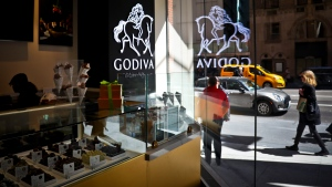 A display of chocolate treats is displayed at Godiva's new cafe in New York, Tuesday April 16, 2019. Godiva, the private Belgium chocolate maker, is looking beyond its iconic gold gift box of chocolates. Some of the traditional stores will be converted into cafes, but it is looking beyond malls and will also have stand-alone storefronts and airport locations. (AP Photo/Bebeto Matthews)