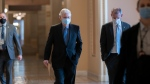 On the first full day of the new Democratic majority in the Senate, Sen. Mitch McConnell, R-Ky., the top Republican, walks to the chamber for the start of business as the minority leader, at the Capitol in Washington, Thursday, Jan. 21, 2021. (AP Photo/J. Scott Applewhite)