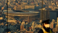 Japan National Stadium, where opening ceremony and many other events are planned for postponed Tokyo 2020 Olympics, is seen from a rooftop observation deck Thursday, Jan. 21, 2021, in Tokyo. (AP Photo/Kiichiro Sato)