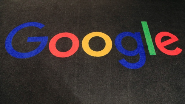 FILE - In this Monday, Nov. 18, 2019 file photo, the logo of Google is displayed on a carpet at the entrance hall of Google France in Paris. (AP Photo/Michel Euler, File)