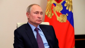 Russian President Vladimir Putin attends a meeting via video conference at the Novo-Ogaryovo residence outside Moscow, Russia, Wednesday, Jan. 20, 2021. (Mikhail Klimentyev, Sputnik, Kremlin Pool Photo via AP)
