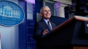 Dr. Anthony Fauci, director of the National Institute of Allergy and Infectious Diseases, laughs while speaking in the James Brady Press Briefing Room at the White House, Thursday, Jan. 21, 2021, in Washington. (AP Photo/Alex Brandon)