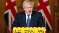 Britain's Prime Minister Boris Johnson speaks at 10 Downing Street in central London on January 15. (Dominic Lipinski/Pool/AFP/Getty Images via CNN)