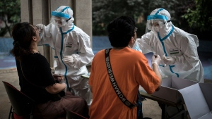 China and the WHO acted too slowly to contain Covid-19, an independent panel says. A medical worker takes a swab from resident for the coronavirus test during community on May 15, 2020, in Wuhan, Hubei, China. (Getty Images via CNN)