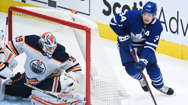 Toronto Maple Leafs centre Auston Matthews (34) tries for a wrap-around on Edmonton Oilers goaltender Mikko Koskinen (19) during second period NHL hockey action in Toronto on Wednesday, January 20, 2021. THE CANADIAN PRESS/Nathan Denette