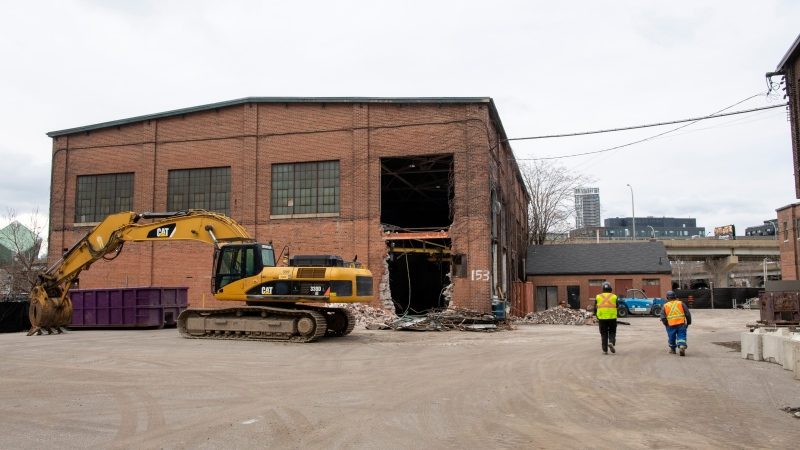 Workers exit the Dominion Wheel and Foundries Company site in Toronto on Tuesday January 19, 2021. The heritage site owned by the Province of Ontario is being demolished under a Municipal Zoning Order. THE CANADIAN PRESS/Frank Gunn