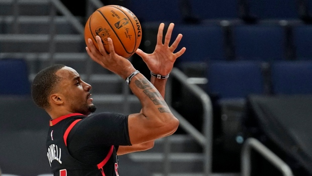 Toronto Raptors guard Norman Powell (24) shoots over Miami Heat guard Duncan Robinson (55) during the second half of an NBA basketball game Friday, Jan. 22, 2021, in Tampa, Fla. (AP Photo/Chris O'Meara)
