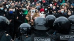 People stand in front of police officers during a protest against the jailing of opposition leader Alexei Navalny in Moscow, Russia, Saturday, Jan. 23, 2021. Russian police on Saturday arrested hundreds of protesters who took to the streets in temperatures as low as minus-50 C (minus-58 F) to demand the release of Alexei Navalny, the country's top opposition figure. (AP Photo/Pavel Golovkin)