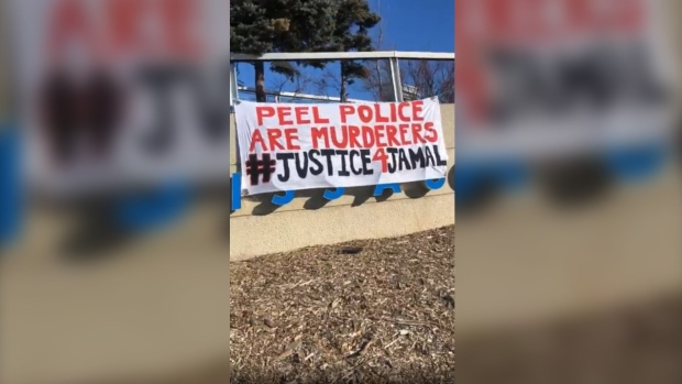 A banner protesting the police-involved killing of 28-year-old Jamal Francique is seen hanging near a busy intersection in Mississauga, Ont. Saturday. (Instagram/Maltonpeoplesmovement)