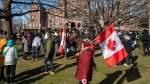 Anti-mask protesters gather on the lawn of the Ontario Legislature n Toronto on Saturday January 23, 2021. The protest travelled through the downtown core for hours and was not stopped by police. THE CANADIAN PRESS/Frank Gunn