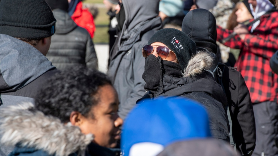 Previously charged anti-mask protester Chris Saccoccia stands in a crowd on the lawn of the Ontario Legislature in Toronto on Saturday January 23, 2021. The protest travelled through the downtown core for hours and was not stopped by police. THE CANADIAN PRESS/Frank Gunn