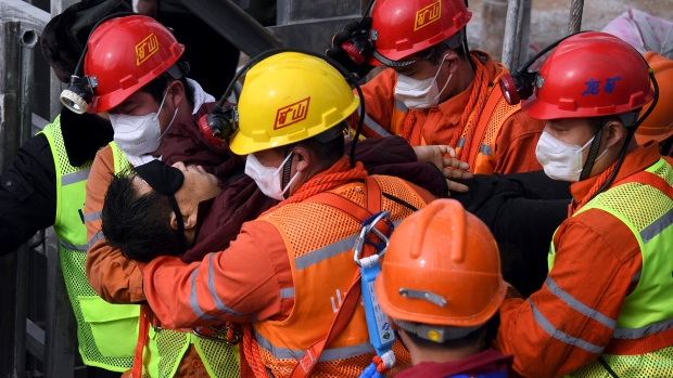 One of 22 trapped miners rescued from Chinese mine