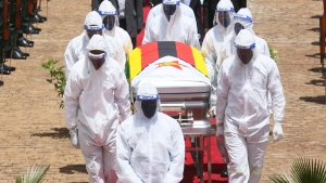 "The burial of Dr Ellen Gwaradzimba who died of COVID-19, at the Heroes Acre in Harare, Thursday, Jan. 21, 2021. Zimbabwean President Emmerson Mnangagwa who presided over the burial called the pandemic ""evil"" and urged people to wear masks, practice social distancing and sanitize, as cases across the country increased amid a fragile health system. (AP Photo/Tsvangirayi Mukwazhi)"