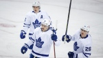 Toronto Maple Leafs' Mitchell Marner, left to right, Auston Matthews, and Jimmy Vesey celebrate a goal during first period NHL hockey action against the Calgary Flames in Calgary, Sunday, Jan. 24, 2021.THE CANADIAN PRESS/Jeff McIntosh