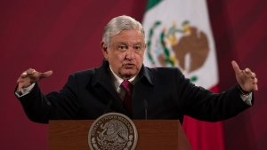FILE - In this Dec. 18, 2020 file photo, Mexican President Andres Manuel Lopez Obrador gives his daily, morning news conference at the presidential palace, Palacio Nacional, in Mexico City. (AP Photo/Marco Ugarte, File)