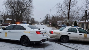 Indianapolis Metropolitan Police Department work the scene Sunday, Jan. 24, 2021 in Indianapolis where five people, including a pregnant woman, were shot to death early Sunday inside an Indianapolis home. (Justin L. Mack/The Indianapolis Star via AP)