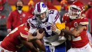 Buffalo Bills quarterback Josh Allen (17) is tackled by Kansas City Chiefs safety Tyrann Mathieu (32) during the second half of the AFC championship NFL football game, Sunday, Jan. 24, 2021, in Kansas City, Mo. (AP Photo/Jeff Roberson)