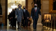 Clerk of the House Cheryl Johnson along with House Sergeant-at-Arms Tim Blodgett lead the Democratic House impeachment managers as they walk through Statuary Hall on Capitol Hill to deliver to the Senate the article of impeachment alleging incitement of insurrection against former President Donald Trump, in Washington, Monday, Jan. 25, 2021. (AP Photo/J. Scott Applewhite, Pool)