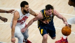 Indiana Pacers guard T.J. McConnell (9) drives past Toronto Raptors guard Fred VanVleet (23) during the first half of an NBA basketball game in Indianapolis, Monday, Jan. 25, 2021. (AP Photo/Michael Conroy)