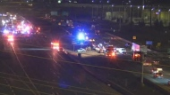 Emergency crews are seen on both sides of the QEW after a major crash near Brant Street on Jan. 26, 2021. (CP24/MTO Traffic Camera)