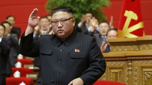 "In this photo provided by the North Korean government, North Korean leader Kim Jong Un acknowledges to the applauds after he made his closing remarks at a ruling party congress in Pyongyang, North Korea Tuesday, Jan. 12, 2021. Kim vowed all-out efforts to bolster his country's nuclear deterrent during the major ruling party meeting where he earlier laid out plans to work toward salvaging the broken economy. Independent journalists were not given access to cover the event depicted in this image distributed by the North Korean government. The content of this image is as provided and cannot be independently verified. Korean language watermark on image as provided by source reads: ""KCNA"" which is the abbreviation for Korean Central News Agency. (Korean Central News Agency/Korea News Service via AP)"