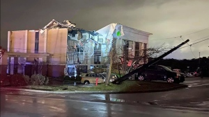A Hampton Inn hotel is severely damaged after a tornado tore through Fultondale, Ala., on Monday, Jan. 25, 2021. (Alicia Elliott via AP)