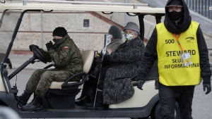 Elderly people wait to be vaccinated against COVID-19 at the temporary hospital at the National Stadium in Warsaw, Poland, on Monday, Jan. 25, 2021. (AP Photo/Czarek Sokolowski)