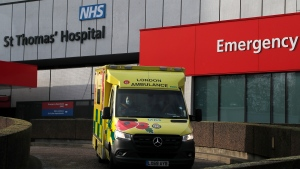 An ambulance drives of a hospital in London, Wednesday, Dec. 30, 2020. Reports say that pressure on the NHS is rising and it is absolutely critical that people follow the rules and do everything they can to stop the spread, especially of the new variant of this virus that transmits so much faster.UK Health Secretary Matt Hancock said on Wednesday the Oxford-AstraZeneca drug approval will accelerate Britain's coronavirus vaccination programme.(AP Photo/Frank Augstein)