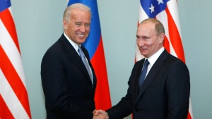 In this March 10, 2011, file photo, then-Vice President Joe Biden, left, shakes hands with Russian Prime Minister Vladimir Putin in Moscow, Russia. Russia and the United States exchanged documents Tuesday Jan. 26, 2021, to extend the New START nuclear treaty, their last remaining arms control pact, the Kremlin said. The Kremlin readout of a phone call between U.S. President Joe Biden and Russian President Vladimir Putin said they voiced satisfaction with the move. (AP Photo/Alexander Zemlianichenko, File)