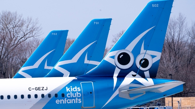 Air Transat aircraft are seen on the tarmac at Montreal-Trudeau International Airport in Montreal, on Wednesday, April 8, 2020. THE CANADIAN PRESS/Paul Chiasson
