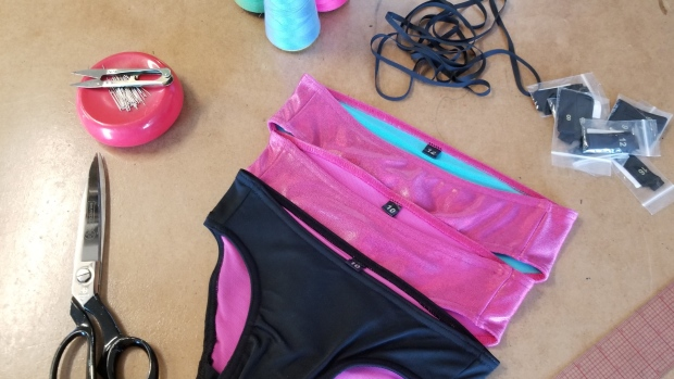 A Canadian clothing line, of which some products are shown in a handout image, is helping transgender kids feel confident at the beach or pool with bathing suits designed to maximize comfort without compromising style. Jamie and Ruby Alexander are the Toronto father-daughter duo behind Rubies, a fledgling fashion business that specializes in form-fitting clothing for trans and non-binary girls. THE CANADIAN PRESS /HO-Rubies-Jamie and Ruby Alexander *MANDATORY CREDIT*