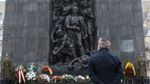 A wreath is laid at the monument to the Heroes of the Warsaw Ghetto in Warsaw, Poland, on Wednesday, Jan. 27, 2021, to recognise Holocaust victims. The Warsaw commemoration is part of world observances of the 76th anniversary of the liberation of Auschwitz, Nazi German death camp where some 1.1 million people, mostly Jewish, were killed during World War II. Most observances were held online, due to the coronavirus pandemic, and only few people attended the ceremony at the monument.(AP Photo/Czarek Sokolowski)