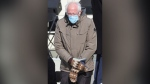 FILE - In this Jan. 20, 2021 file photo, Sen. Bernie Sanders, I-Vt., wears mittens as he attends President Joe Biden's inauguration ceremony at the U.S. Capitol in Washington. Sanders says the wooly mittens he wore to the ceremony that sparked endless quirky memes across social media have helped to raise $1.8 million in the last five days for charitable organizations in his home state of Vermont through the sale of T-shirts, sweatshirts and stickers with the iconic image of him sitting with his arms and legs crossed in his brown parka and recycled wool mittens (Jonathan Ernst/Pool Photo via AP)