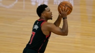 Toronto Raptors guard Kyle Lowry shoots against the Golden State Warriors during the first half of an NBA basketball game in San Francisco, Sunday, Jan. 10, 2021. (AP Photo/Jeff Chiu)