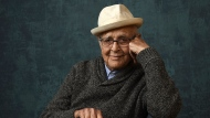 "FILE - Norman Lear, executive producer of the Pop TV series ""One Day at a Time,"" poses for a portrait during the Winter Television Critics Association Press Tour on Jan. 13, 2020, in Pasadena, Calif.. The Golden Globes will bestow the Carol Burnett Award to Lear during the 78th annual awards ceremony next month. The Hollywood Foreign Press Association announced Thursday, Jan. 28, 2021, that Lear will be honored during the Feb. 28 event. (AP Photo/Chris Pizzello, File)"