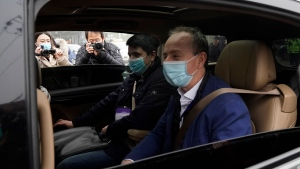 Members of a World Health Organization team arrive at the Hubei Center for Disease Control and Prevention in Wuhan in central China's Hubei province Monday, Feb. 1, 2021. (AP Photo/Ng Han Guan)