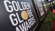Event signage appears above the red carpet at the 77th annual Golden Globe Awards, Sunday, Jan. 5, 2020, in Beverly Hills, Calif.  (Photo by Jordan Strauss/Invision/AP, File)