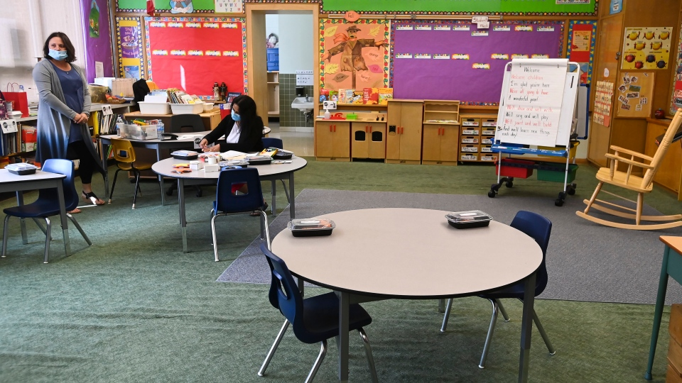 Teachers prepare in their kindergarten classroom at Hunter's Glen Junior Public School which is part of the Toronto District School Board (TDSB) during the COVID-19 pandemic in Scarborough, Ont., on Monday, September 14, 2020. THE CANADIAN PRESS/Nathan Denette