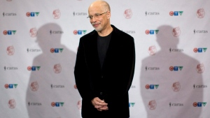 Dan Hill poses for photographers at the Juno Awards in Toronto on Sunday March 27, 2011. THE CANADIAN PRESS/Chris Young
