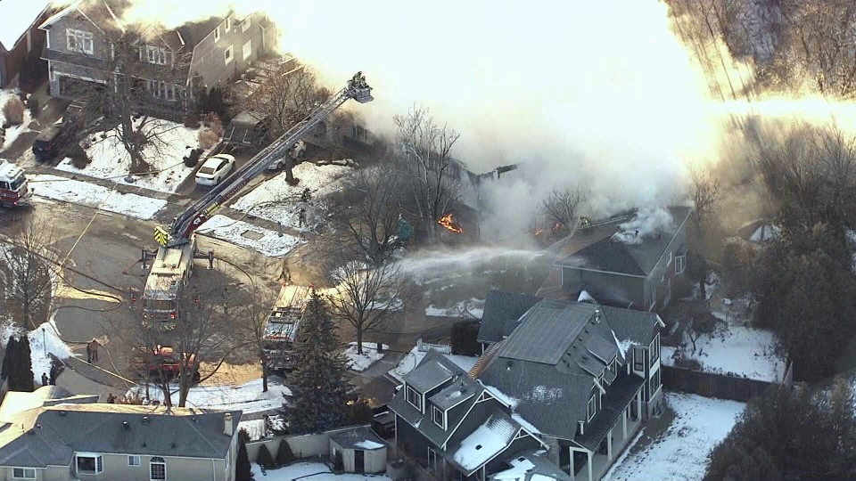 Emergency crews respond to a fire at a home in Oakville on Thursday morning.