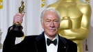 "Christopher Plummer poses with the Oscar for best supporting actor for his work in ""Beginners"" during the 84th Academy Awards on Feb. 26, 2012, in the Hollywood section of Los Angeles. Plummer, the dashing award-winning actor who played Captain von Trapp in the film ""The Sound of Music"" and at 82 became the oldest Academy Award winner in history, has died. He was 91. Plummer died Friday morning, Feb. 5, 2021, at his home in Connecticut with his wife, Elaine Taylor, by his side, said Lou Pitt, his longtime friend and manager. (AP Photo/Joel Ryan, File)"