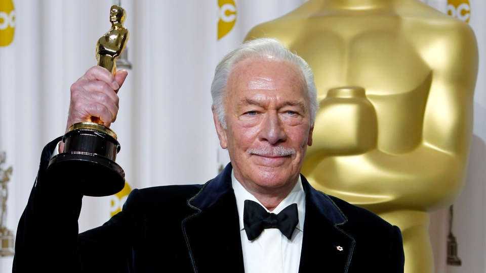 """Christopher Plummer poses with the Oscar for best supporting actor for his work in """"Beginners"""" during the 84th Academy Awards on Feb. 26, 2012, in the Hollywood section of Los Angeles. Plummer, the dashing award-winning actor who played Captain von Trapp in the film """"The Sound of Music"""" and at 82 became the oldest Academy Award winner in history, has died. He was 91. Plummer died Friday morning, Feb. 5, 2021, at his home in Connecticut with his wife, Elaine Taylor, by his side, said Lou Pitt, his longtime friend and manager. (AP Photo/Joel Ryan, File)"""