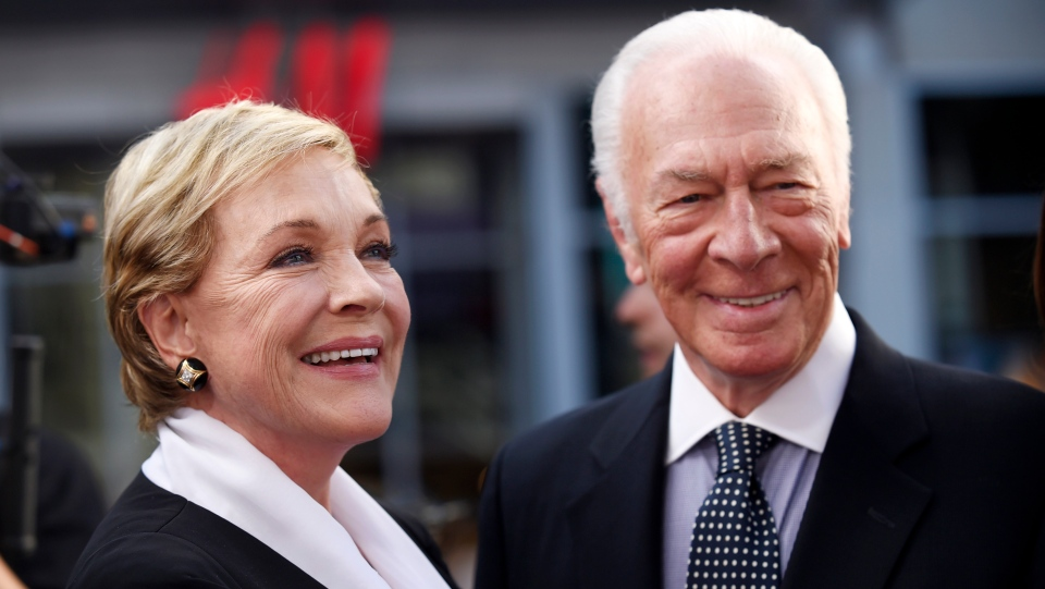 """Julie Andrews, left, and Christopher Plummer, cast members in the classic film """"The Sound of Music,"""" pose together before a 50th anniversary screening of the film on the opening night of the TCM Classic Film Festival on March 26, 2015, in Los Angeles. (Photo by Chris Pizzello/Invision/AP, File)"""