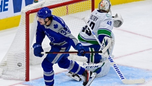Toronto Maple Leafs centre Auston Matthews (34) scores on Vancouver Canucks goaltender Braden Holtby (49) during first period NHL hockey action in Toronto on Saturday, February 6, 2021. THE CANADIAN PRESS/Frank Gunn