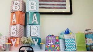 FILE - In this Sept. 1, 2019 file photo, unopened gifts are displayed during a baby shower in the U.S. (AP Photo/David Goldman, File)